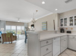 10-TOPS'L-Beach-Manor-Unit-C-1004-Open-Living-Dining-Kitchen-View