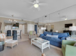 5-TOPS'L-Beach-Manor-Unit-C-1004-Open-Living-Dining-Kitchen