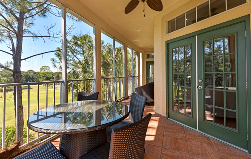 Screened porch at Tivoli townhouse in Sandestin overlooking golf course.