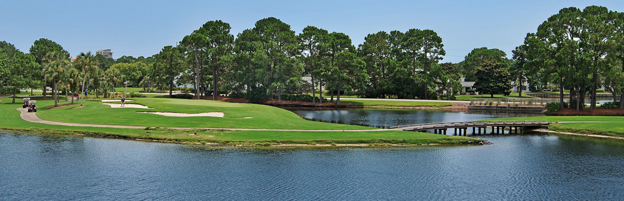 Golf course at Sandestin with lake and bridge.