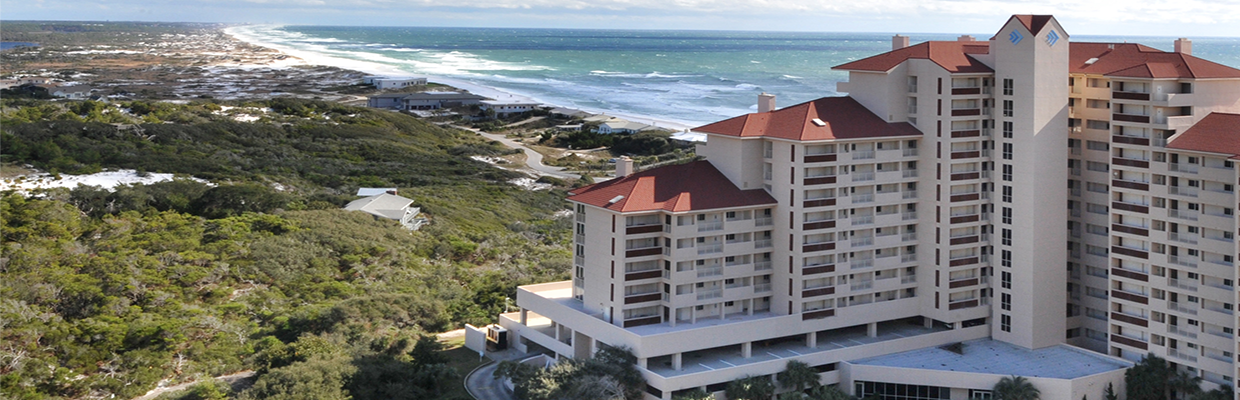 Tops'l Beach Resort condo building overlooking Coffeen Nature Preserve and the Gulf of Mexico.